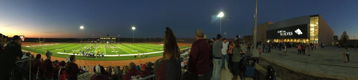 football-field-pano-with-school